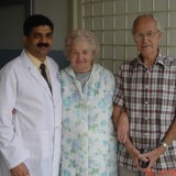 Dr. Subodh Shetty with patients in UK